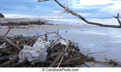 Plastic garbage waste water pollution on beach by ocean sea