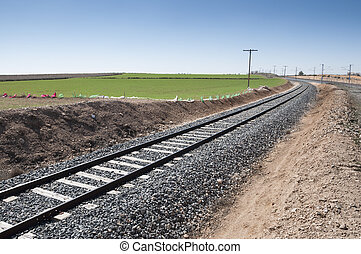 Conventional rail in an agricultural landscape in Toledo...