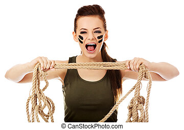 Young screaming soldier woman tugging a rope.