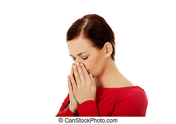 Young sneezing woman with sinus pain.