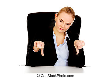 Unhappy business woman with thumbs down
