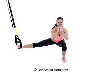 Functional exercises - Athletic woman with functional loops...