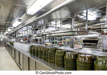 Commercial Kitchen with Serving Domes - Stacks of Empty...