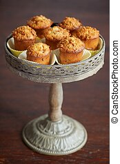 Muffins on cake stand - Plum muffins on cake stand on wooden...