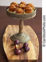 Muffins on cake stand - Plum muffins on cake stand with some...