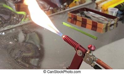 Burning of gas lighter in workshop, industry