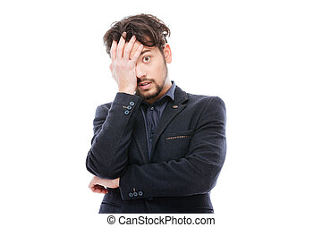 Sad businessman standing isolated on a white background