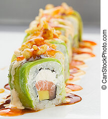Sushi with avocado salmon and cheese. Crunch Roll - Sushi...