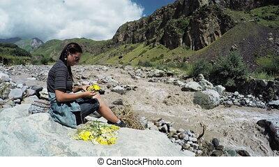 Girl on shore mountain river