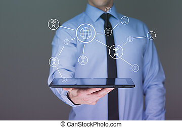 businessman holding a tablet pc. Shows telecommunication towers. communication concept