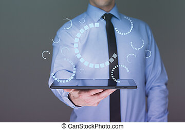 businessman hand touch  gear to success as concept. Business man using tablet PC.