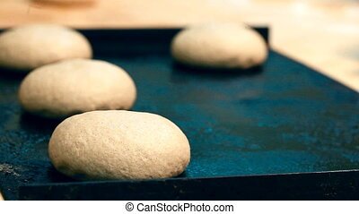 A baker is putting the pastry on a baking sheet - The chef...