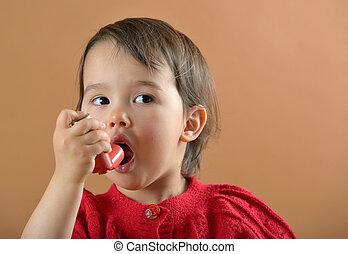 girl breathing asthmatic medicine - Little girl breathing...