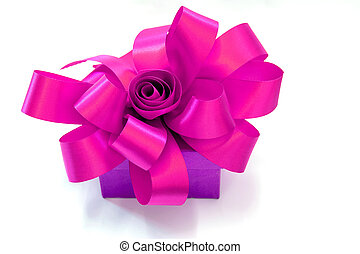 Gift box tied with a pink ribbon bow on white background.