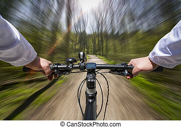 Fast Bike Ride through the woods - Low perspective of a bike...