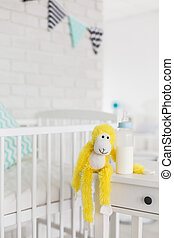 Special place for favourite toy - Shot of a yellow monkey...