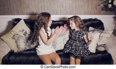 cute Little sisters hugging