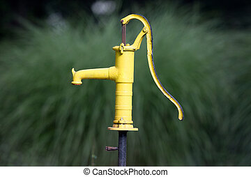 Water pumping well - Yellow old water pumping well in...