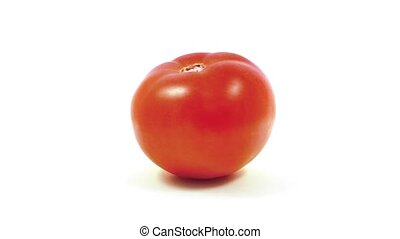 Single Tomato Rotating On White