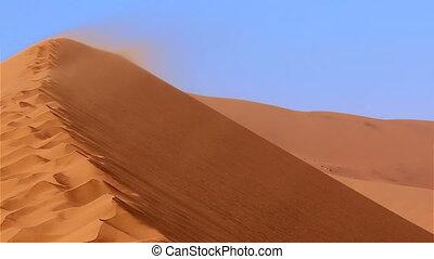 Namib desert dune Sossusvlei sandst - Sandstorm on dune...
