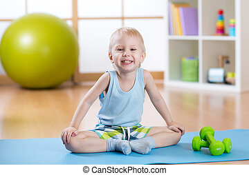 Child boy ready to fitness exercises - Smiling funny child...