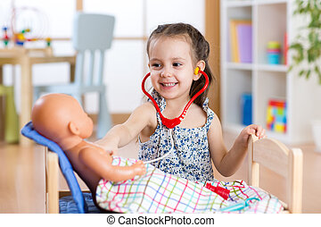child playing doctor with toy at home