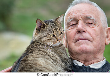 Senior man with cat - Portrait of old man with his tabby cat...