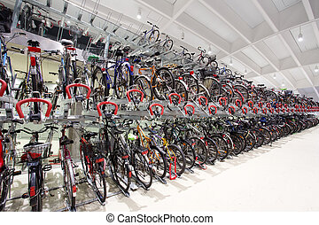 Covered bicycle garage - Many bicycles parked in covered...