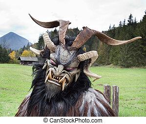 Alpine traditional Krampus mask - Man wearing traditional...