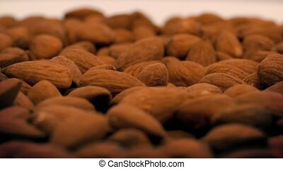 Almonds Rotating Closeup - Almond nuts slowly turning on...