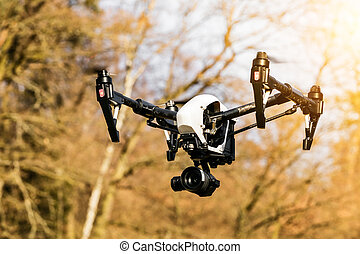 Drone flying near forest - Drone with HD camera, flying near...