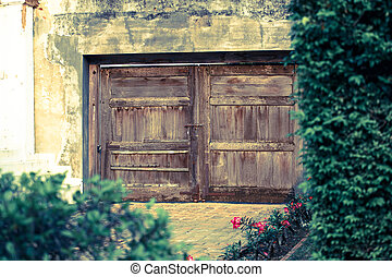Old wooden door on the wall