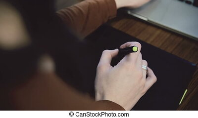 Woman hands working on graphic tablet slider - Hands working...