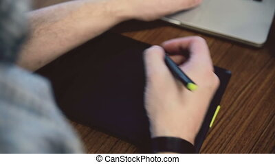 Man hands working on graphic tablet.