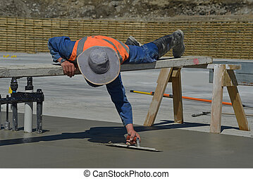 another concrete pour - A builder uses a sawhorse and plank...