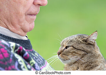 Senior man with cat - Close up of senior man holding his cat...