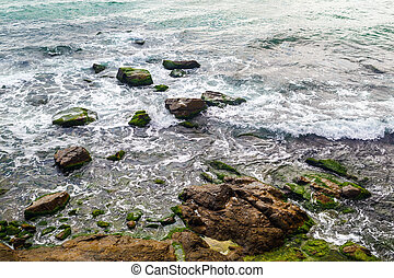 Rocky shore and sea - Close-up of rocky shore with sea water...