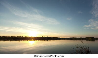 lake with reflection on the water, timelapse of from day to...