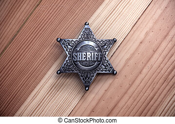sheriff - metal sheriff star on wood background