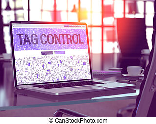 Tag Control on Laptop in Modern Workplace Background. - Tag...