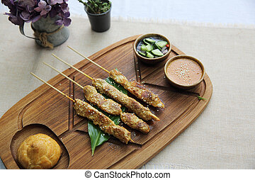 Chicken Satay on wood