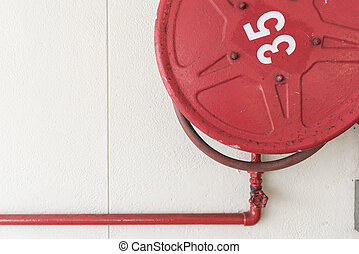 Red Fire Hoses - Red fire hoese on the wall