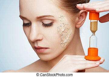beauty concept rejuvenation, renewal, skin care, skin problems with hourglass