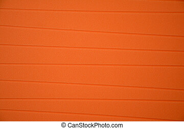 Orange rubber tablemat closeup - Orange rubber tablemat with...