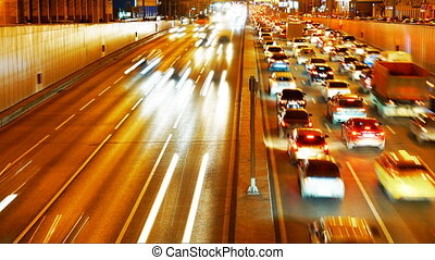 Car traffic transport congestion on city street at night -...