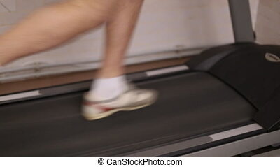 running legs on a treadmill closeup