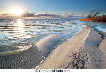 sunshine over big Ijsselmeer lake coast, Friesland,...