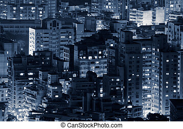 Night scene of buildings illuminated in modern city.