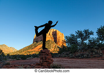 Woman Silhouetted in Yoga Pose