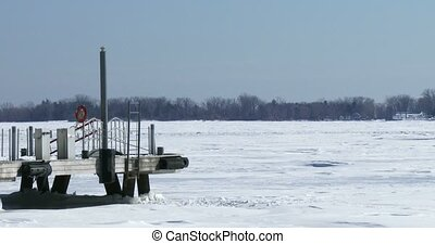 Dock on frozen lake Ontario in front of Toronto's waterfront...